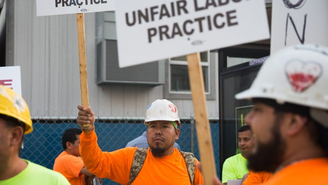 Omni Hotel construction workers go on strike in demand of fair and equal pay. June 16, 2017.