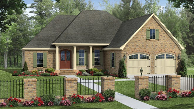 Classic brick, graceful porch columns, and a surprisingly elegant garage give this home lovely curb appeal.