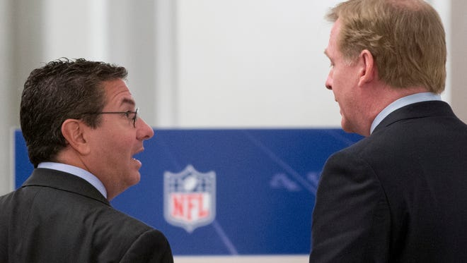 Washington Redskins football team owner Daniel Snyder, left, and NFL Commissioner Roger Goodell, right, talks during a break in the NFL fall meeting in Washington D.C. in October. Snyder has said he will never change the name of his team, the Redskins, despite protests that it is a racist and disparaging reference to Native Americans.