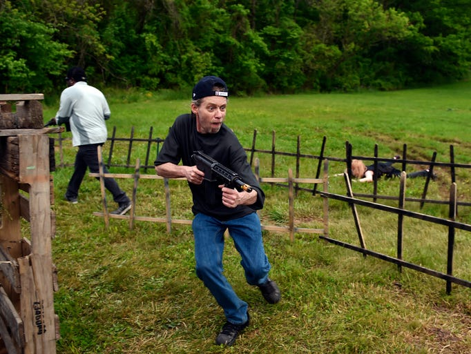 Rusty Kratzer of Harrisburg aims at a zombie, not pictured,