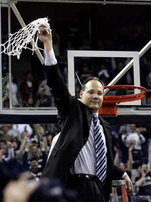 Mark Fox holds up the net after Nevada won the 2006 WAC Tournament title. He is one of six individuals in the Wolf Pack's 2016 Hall of Fame class.