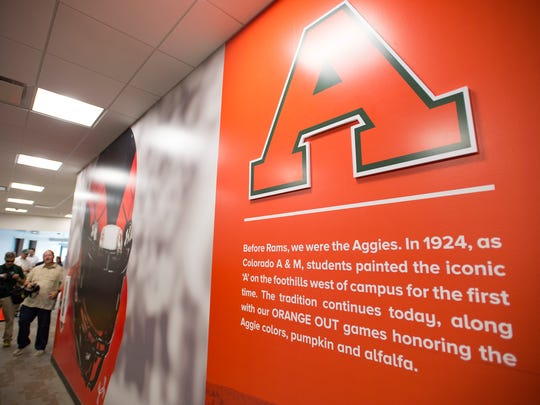 Murals line the entry way of the players lounge at the new CSU football stadium on Tuesday, July 18, 2017.