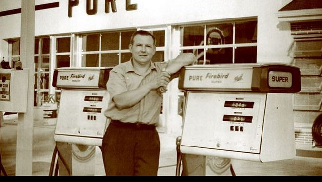 Photo of Vernon Baltus in his younger years leaning on the gas pumps of the station at the intersection of Fifth Street and Chestnut Avenue.