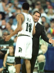 Head coach Tom Izzo of Michigan State congratulates his player Charlie Bell #14 during the semifinal round of the NCAA Final Four against at the RCA Dome in Indianapolis, Indiana.  Michigan State won the game 53-41, advancing to the final round on Monday.