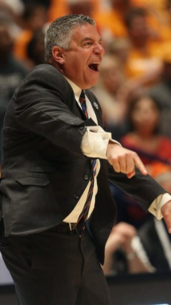 Auburn head coach Bruce Pearl directs his team against