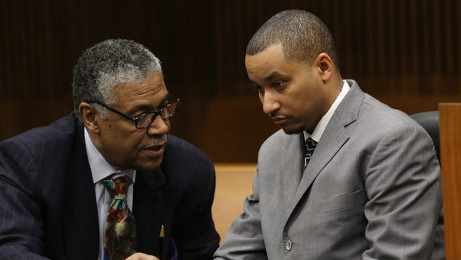 Attorney Godfrey Dillard talks to his client, State Senator Virgil Smith before he admits guilt and enters a plea deal before Wayne County's Circuit Judge Lawrence Talon on Thursday, February 11, 2016, at the Frank Murphy Hall of Justice in Detroit.