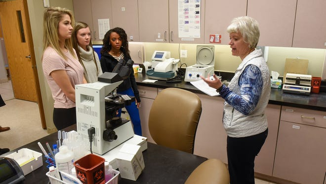 Lab supervisor Patricia Leyk explains operations in part of the medical lab Friday, Jan. 19, during a tour of the St. Cloud Medical Group's Northwest Clinic in St. Cloud.