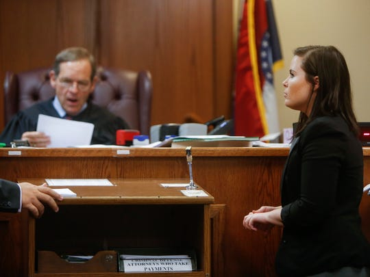 Public defender Dawn Calvin listens to the prosecutor while in Judge Dan Imhof's courtroom on Thursday, Oct. 20, 2016.