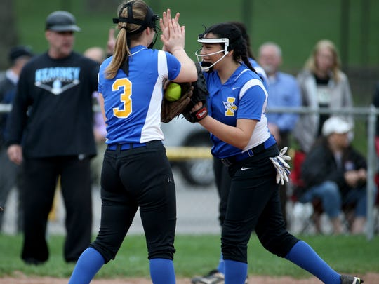 Irondequoit's Marlayna Cartagena (12) and Ayana Chodak