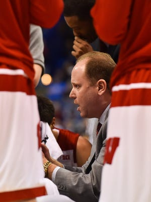 Wisconsin Badgers coach Greg Gard speaks to his team during the first half of the game in the first round against the Pittsburgh Panthers in the 2016 NCAA tournament at Scottrade Center.