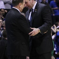 Mar 29, 2013; Indianapolis, IN, USA; Michigan State Spartans head coach Tom Izzo (left) greets Duke Blue Devils head coach Mike Krzyzewski (right) after the semifinals of the Midwest regional of the 2013 NCAA tournament at Lucas Oil Stadium. Mandatory Credit: Brian Spurlock-USA TODAY Sports