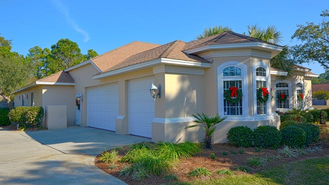 4612 Soundside Drive, features a side-entry garage.