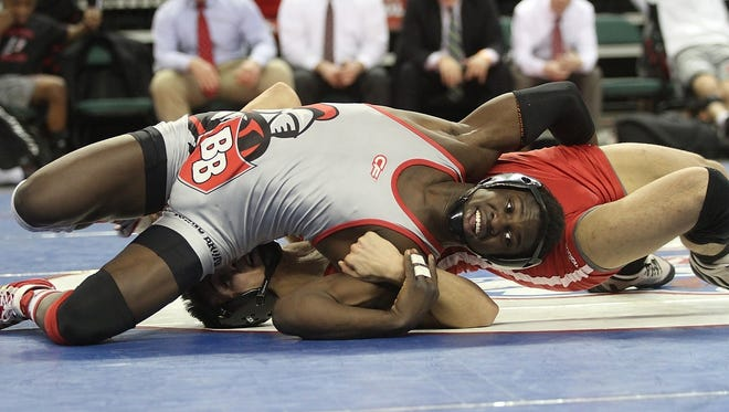 Mickey Croce of Paulsboro wrestles Stephan Glasgow Bound Brook, front, in the 145lb bout.