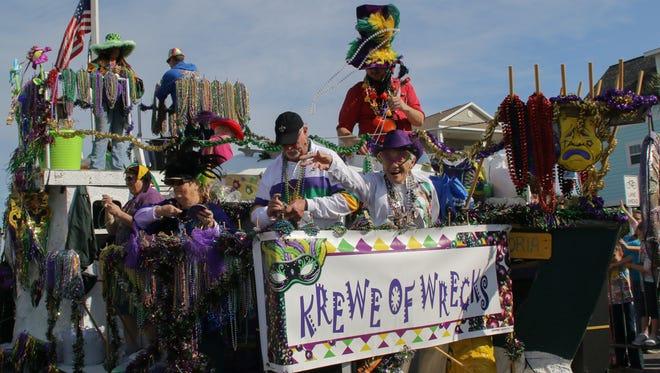 Thousands enjoy the 2015 Krewe of Wrecks Mardi Gras Parade on Pensacola Beach Sunday afternoon.