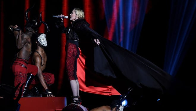 Madonna just before she falls on stage during the Brit Awards 2015 at The O2 Arena on February 25 in London, England.