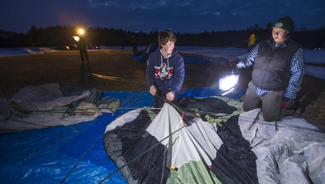 Johnny Benvenuto (left) and Jacob Wechsler, members of the Mt. Mansfield Union High School football team, set up their tent in Jericho on Friday, March 27, 2015. The team is participating in the Spectrum Sleep Out, an annual fundraiser for Spectrum Youth and Family Services.