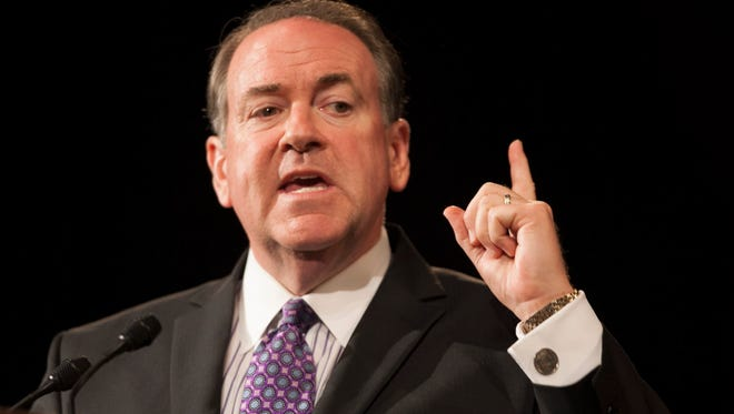 Former Arkansas Gov. Mike Huckabee speaks during the Republican state convention on Friday, June 6, 2014, at the Grand Wayne Center in Fort Wayne, Indiana.