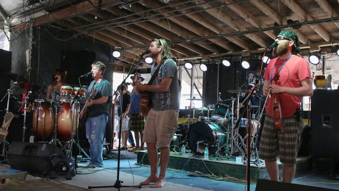 Southern Drawl Band performs during the 31st annual Flora-Bama Interstate Mullet Toss and Gulf Coast's Greatest Beach Party Friday.