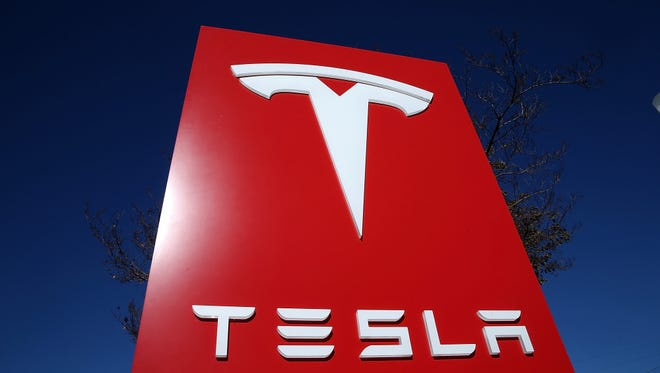 A sign is posted at a Tesla showroom on November 5, 2013 in Palo Alto, California.