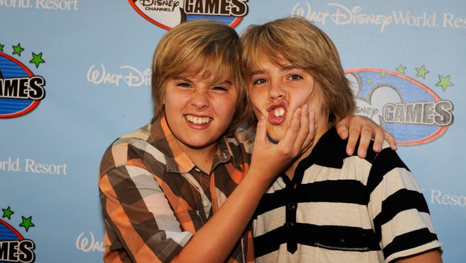 """Dylan Sprouse, left, and Cole Sprouse, stars of the Disney Channel series """"The Suite Life of Zack and Cody,"""" pose on the red carpet at EPCOT center for the Disney Channel Games in Lake Buena Vista, Fla., Friday, May 2, 2008."""