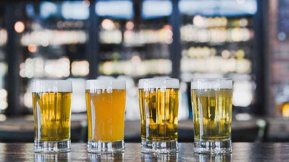 A flight of beer is pictured at a World of Beer location.