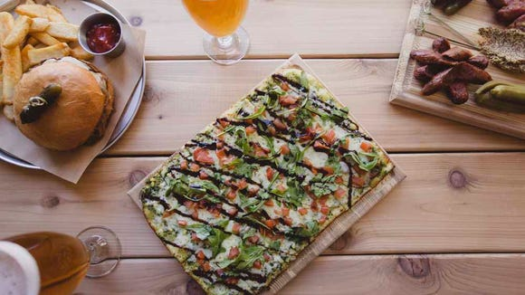 World of Beer offers a variety of menu items such as burgers, flatbreads and appetizers.