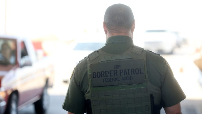 A Border Patrol Agent checks for citizenship and contraband at the Border Patrol checkpoint on the 86 Expressway Highway near Salton City. This is the last checkpoint before the highway connects to the major Interstate 10 Freeway.