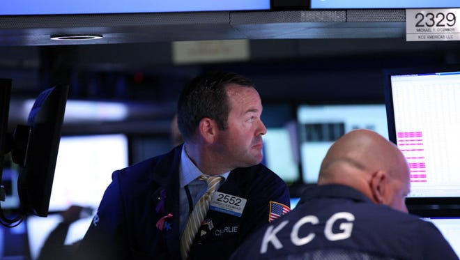 Traders work on the floor of the New York Stock Exchange (NYSE) on July 6, 2015 in New York City.