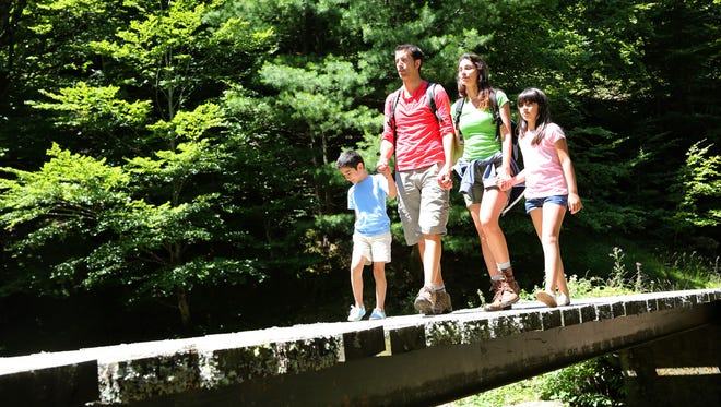 Family walking outdoors.