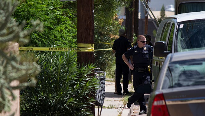 Police remained outside the apartment near Colter Street and 13th Place on Saturday, July 25, 2015, after a woman's decapitated body was discovered.
