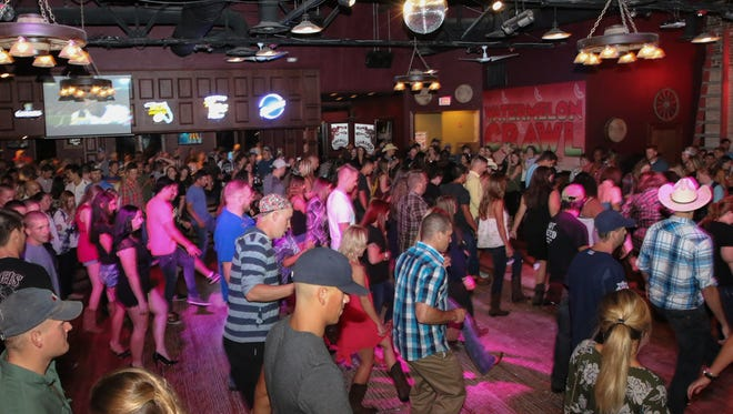 Wild Greg's Saloon celebrates its first year of being open in downtown Saturday night.