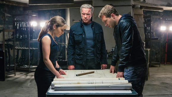 Left to right: Emilia Clarke plays Sarah Connor, Arnold Schwarzenegger plays the Terminator, and Jai Courtney plays Kyle Reese in the motion picture 'Terminator Genisys'