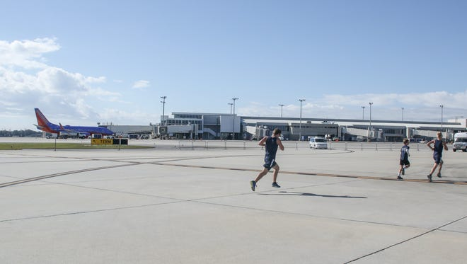 Hundreds of people participated last year in the Pensacola International Airport Runway Run 5K. The annual race returns Dec. 3. The event helps raise money for USO Northwest Florida.