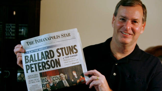 Greg Ballard holds The Indianapolis Star the morning after winning the election for mayor Wednesday, November 7, 2007 in his Indianapolis home.