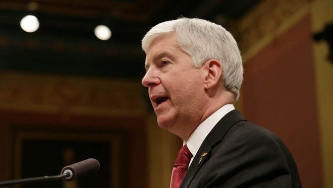 Gov. Rick Snyder addresses the Flint water crisis during his State of the State speech on Tuesday at the state Capitol Building in Lansing.