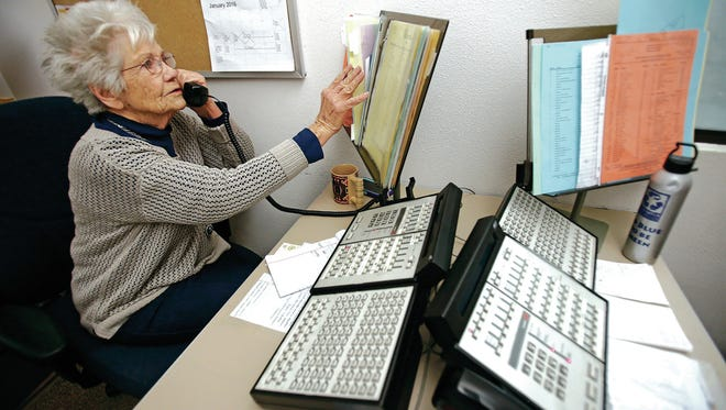 Martha Canon of Santa Fe works the switchboard at the state Capitol earlier this month. Canon is on her 32nd legislative session.