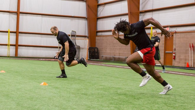 Rutgers football products Quentin Gause (front) and Sam Bergen (back) run the 40-yard dash at Parabolic Performance & Rehab.