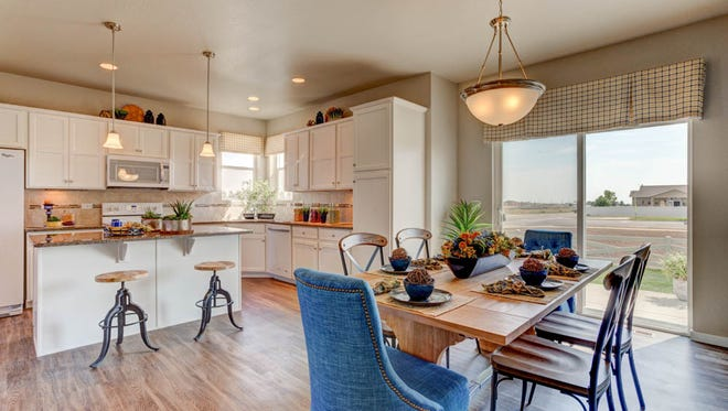 Using consistent colors throughout the home creates a cohesive style.  This is the Remington II Floor Plan at Harvest Village in Wellington.