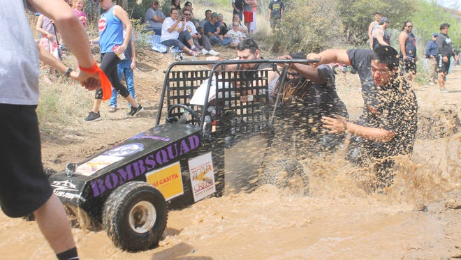The Bomb Squad races through the mud pit en route to their victory Sunday during the Great Race.