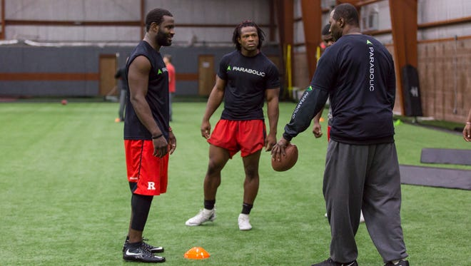 Rutgers linebackers Steve Longa and Quentin Gause (center) work with former pro Al Singleton at Parabolic Performance & Rehab.