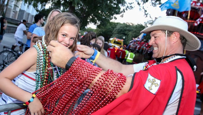 A member of the Krewe of Andres de Pez presents beads to a parade-goer during the 2016 Fiesta of Five Flags' Pen Air Grand Fiesta Parade. This year's parade rolls through downtown Pensacola on Friday.