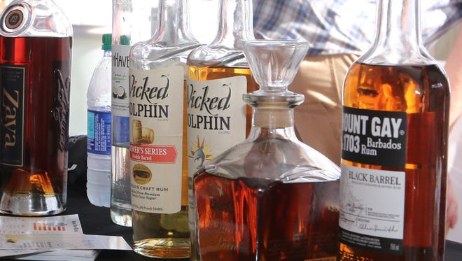 People make their way through the Pensacola Beach Rum Festival Saturday afternoon at the Sandshaker.