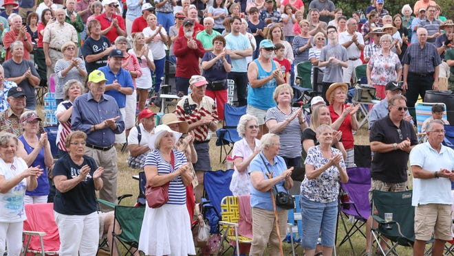 """Hundreds of people attended the inaugural Memorial Day concert performed by the Pensacola Civic Band at the Randall K. and Martha A. Hunter Amphitheater behind Blue Wahoos Stadium on Monday.  Directed by Don Snowden, the band performed """"Semper Fidelis,"""" """"God Bless the U.S.A."""", """"Hymn for the Innocent"""" and many more during the nearly ninety minute concert."""
