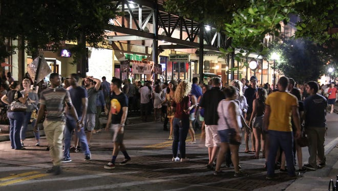 People make their way through July's Gallery Night downtown Friday night.