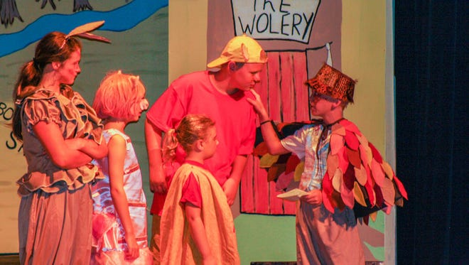 Winnie the Pooh (center) played by Collin Lukes, talks with Owl (right) played by Ethan Stokes, while Mary Iannitello looks on as Kanga (left), Mazie Frahm as Piglet and Chloe Johanek as Pooh's Tummy.