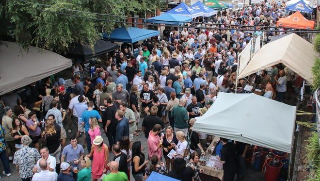 Hundreds of people make their way through Seville Quarter during last year's Emerald Coast Beer Festival. The event returns Friday.