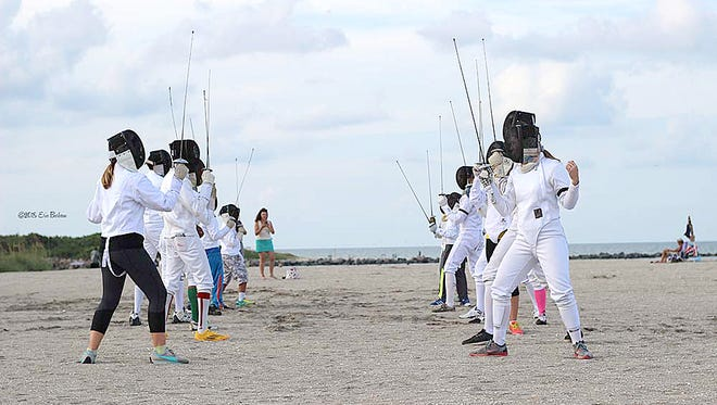 "Erin Barbeau took this photo during the ""Treasure Coast Fencing Club's Fencing Flash Mob at Fort Pierce Jetty Beach. This image was originally used in Sept. 2016."