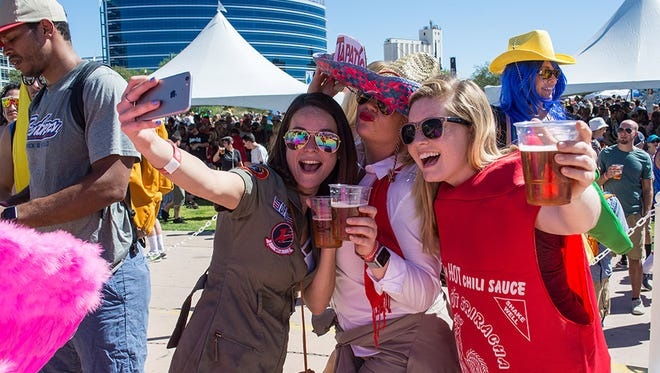 Revelers at the annual bicycle and beer festival Tour de Fat, put on by Colorado-based New Belgium Brewing in Tempe on Saturday, Oct. 1, 2016. The festival includes a bicycle parade, concerts and activities to raise money for local bike-based charities.