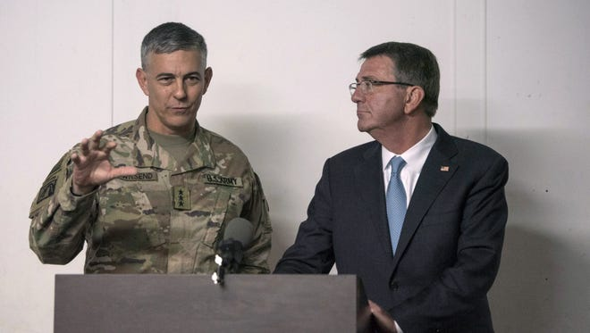 Defense Secretary Ash Carter listens as U.S. Army Lt. Gen. Stephen Townsend, commander of Combined Joint Task Force-Operation Inherent Resolve, speaks during a news conference in Irbil, Iraq, on Oct. 23, 2016.