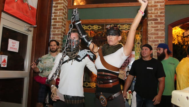 The 1st place winners in the downtown O'Riley's Irish Pub Halloween costume contest Saturday night.